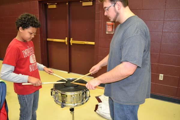 Student trying a snare drum