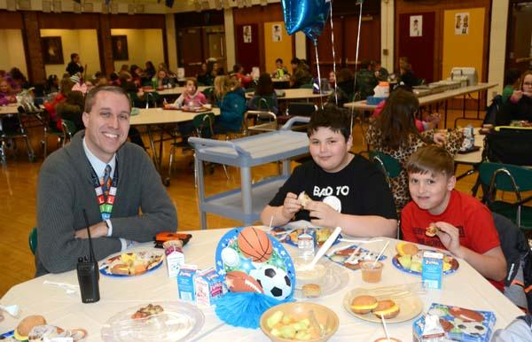 Photo of Mr. Zeck having breakfast with students